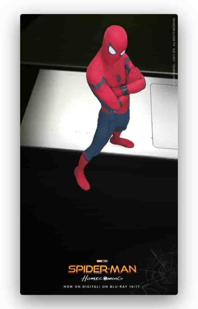Virtual Spider Man Standing On A Table In  Real Time On Phone's Screen Camera